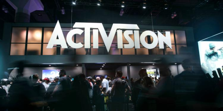 Attendees walk past Activision Blizzard Inc. signage during the E3 Electronic Entertainment Expo in Los Angeles, California, U.S., on Wednesday, June 14, 2017. Photographer: Patrick T. Fallon/Bloomberg